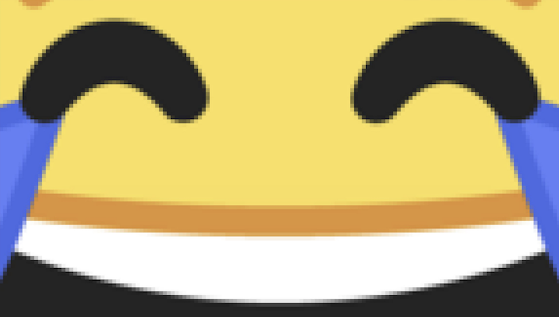 zoomed-in emoji of laughing tears of joy with squares of pixels distinguishable