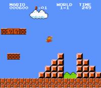 screenshot of Mario jumping over adjacent pyramids